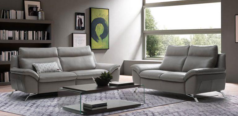 Sofá relax en piel Natuzzi, respaldo alto, patas metálicas, de diseño moderno, sofá de tres plazas